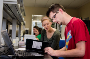 Senior Annie Keller and 2013 alumnus Jimmy Altendahl work on problem sets in a lab in Owens Science Hall in 2012. U.S. News and World Report gave St. Thomas a No. 112 national ranking in the liberal arts category Tuesday. (Rita Kovtun/TommieMedia)