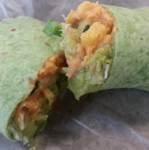 A vegan-friendly wrap; Red Pepper Hummus, Guacamole, corn and lettuce. This is an example of one of my meals from the week. (Caroline Rode/TommieMedia)