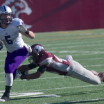 Running back Jack Kaiser attempts to evade an Auggie defender.  Kaiser rushed the ball seven times for 52 yards and one touchdown in the first half (Andrew Stafford/TommieMedia).