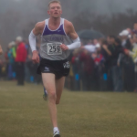 Junior Keaton Wendroth runs toward the finish line in the last stretch of Saturday's race. The St. Thomas men placed 7th out of 26 teams in the NCAA central region championships, while the women's team finished 14th out of 27 teams. (Jacob Sevening/TommieMedia)