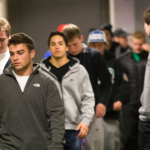 A dejected St. Thomas football team exits the locker room after finding out their season would come to an end following the division III football selection show. (Andrew Stafford/TommieMedia)