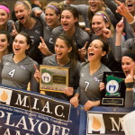 The women's volleyball team celebrates its MIAC playoff championship victory. The Tommies went 30-3 on the season, losing to Wisconsin-Stevens Point in the NCAA regional championship. (Morgan Neu/TommieMedia)