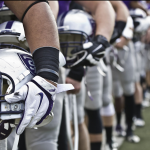 St. Thomas football players line up before an Oct. 26 game against Hamline University. (Eric Wuebben/TommieMedia)