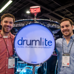 Jeff Sevaldson (left) and Joey Nesbitt (right) proudly display their illuminated drum.  Drumlite drums were used by the Red Hot Chili Peppers at the Super Bowl halftime show. (Photo courtesy of Alex Matthews)