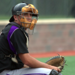 Catcher J.D. Dorgan looks over to the St. Thomas dugout during the final game of the 2013-14 season. Dorgan batted .365 with 50 hits on the season. (Ross Schreck/TommieMedia)