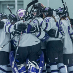 The Tommies gather together for a group hug to celebrate their 2-0 shutout and MIAC championship victory. St. Thomas will take on Wis. Stevens Point in the quarterfinals of the NCAA tournament. (Christina Theodoroff/TommieMedia)