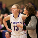 Coach Ruth Sinn lends some advice to Brandenburg. St. Thomas won the MIAC playoffs and earned an automatic bid to the NCAA tournament. (Jake Remes/TommieMedia).