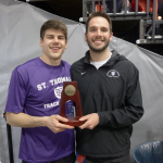 St. Thomas senior Max Dunne displays his All-America trophy with Coach Erik Diley. Dunne was named an All-American in the heptathlon for the second time in his career. (Photo Courtesy of Butch Dunne).
