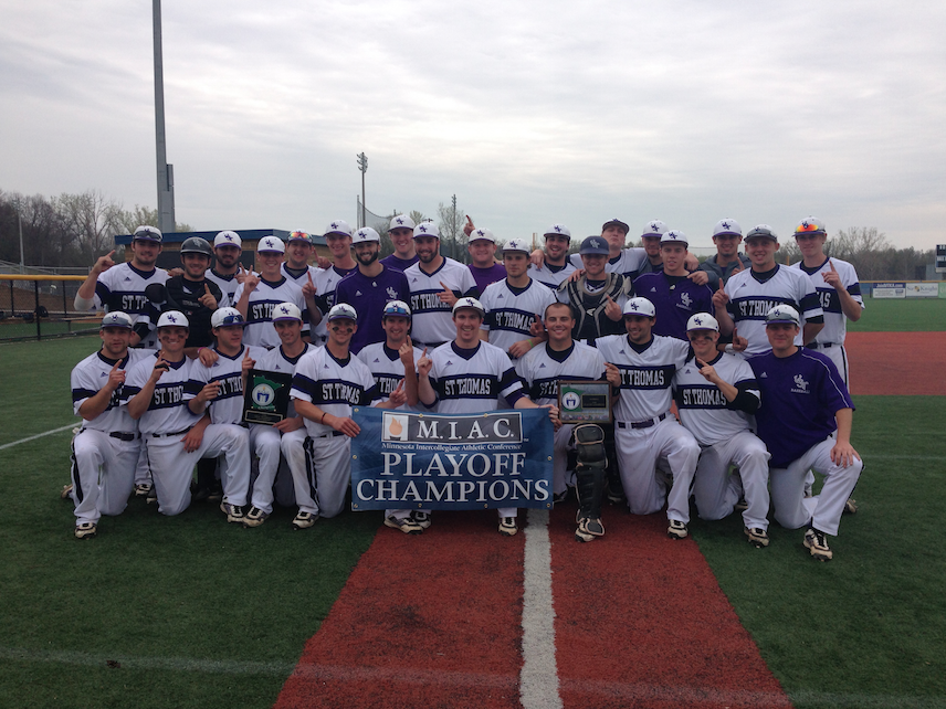St. Thomas poses with its MIAC tournament championship banner on Sunday afternoon in Minnetonka. The Tommies defeated the Bethel Royals 3-1 to earn the postseason title. (Photo courtesy of Kate Osterman)
