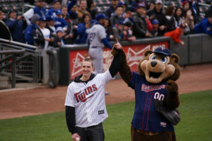Joe Seifert and Minnesota Twins mascot T.C. Bear celebrate Seifert's first pitch before a May 1 game against the Los Angeles Dodgers. With the help of his RA, Seifert got the chance to throw the first pitch. (Photo Courtesy of Joe Seifert Sr.)