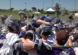 The St. Thomas club lacrosse team gathers together. St. Thomas defeated North Dakota State 8-6 Tuesday to advance to the final four. (Photo credit to  Brian Schublooom)