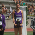 Senior Mallory Burnham accepts her first-place award after the 100-meter hurdles at the NCAA Division-III Outdoor Championships. Burnham placed in the top two of all three of the events she competed in. (Courtesy of Mallory Burnham)