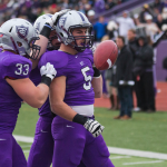 Running back Jack Kaiser flips the ball to the referee after scoring a touchdown against Concordia-Moorhead last fall. Kaiser said he hopes the football team's momentum will carry over into the 2014 season. (Andrew Stafford/TommieMedia)