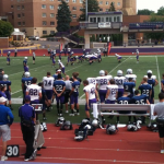 The St. Thomas first-team offense and defense ready for their next play. The football team held its last scrimmage before its season opener Sept. 6. (Tom Pitzen/ TommieMedia)