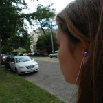 A student listens to music on her way to campus. On Aug. 31, a Minneapolis woman was hit and killed by a Green Line and is thought to have been wearing headphones at the time. (Lauren Schaffran/TommieMedia)