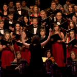 St. Thomas choirs and instrumental ensembles prepare for the 25th annual Christmas concert in the Minneapolis Convention Center in 2012. The music department received an Emmy nomination for its 2013 Christmas concert this month. (Stephanie Dodd/TommieMedia)