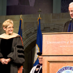 President Julie Sullivan shares the stage with President Emeritus the Rev. Dennis Dease at her inauguration last year. Sullivan is now beginning the second year of her presidency. (Morgan Neu/TommieMedia)