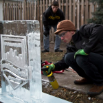 Robbie Harrell works on a sculpture as former partner Stu Lombardo looks on. The two started Minnesota Ice Sculptures last year. (Eric Wuebben/TommieMedia)