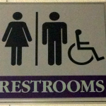 A current restroom sign in the Anderson Student Center indicates both male and female bathrooms. A recent Minneapolis resolution encouraged gender-neutral bathrooms to accommodate for transgender people. (Lauren Smith/TommieMedia)
