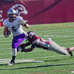 Running back Jack Kaiser evades an Auggie defender on a run during the first half last season. St. Thomas will take on Augsburg, which has scored more than 130 points this season, on Saturday. (Andrew Stafford/TommieMedia)
