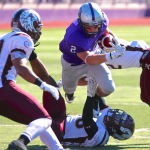 St. Thomas running back Nick Waldvogel carries the ball past Augsburg. Waldvogel scored three touchdowns before halftime at Saturday's Homecoming game. (Carlee Hackl/TommieMedia)