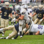 Running back Jack Kaiser busts through the Royal defense during the second quarter of last year's game. Kaiser finished the game with 140 yards and two touchdowns on 32 attempts. (Andrew Stafford/TommieMedia)