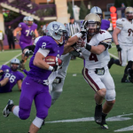 Running back Nick Waldvogel stiff-arms Cobber safety Bryce Hentges during a run in the fourth quarter of last year's game. Waldvogel ran for 100 yards on 15 attempts, including a touchdown in the Tommies' 34-20 win. (Andrew Stafford/TommieMedia)