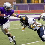 Running back Brenton Braddock stiff-arms a Carleton cornerback in last year's game. Coach Glenn Caruso said the Tommies will need to devote attention to Saturday's game. (Eric Wuebben/TommieMedia)