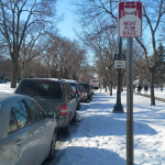St. Thomas students, faculty and staff park their cars along Summit Avenue, a night plow route. Now that the city's street sweep has been canceled, attention turns to parking restrictions caused by snow emergencies. (Rebecca Mariscal/TommieMedia)