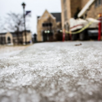 Sleet covers the sidewalk on the Lower Quad Tuesday. Despite slippery conditions, St. Thomas did not cancel classes. (Jake Remes/TommieMedia)