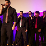 "Senior Mike Fairbairn sings Katy Perry's ""Wide Awake"" at the Summit Singers' concert last semester. The group plans to put a mix of new and old songs on its upcoming album. (Rebecca Mariscal/TommieMedia)"