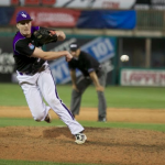 Pitcher Greg Clute hurls a pitch to home plate against Wisconsin-Whitewater during the NCAA Division-III Championships last season. The Tommies will see the No. 1 ranked Warhawks again on March 25. (Jacob Sevening/TommieMedia)
