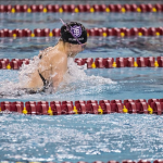 Senior Emily Punyko surfaces for a breath while swimming the 200 medley relay at last year's MIAC Championships. Punyko was recognized as an Honorable Mention for her role in this year's 200 free relay at the NCAA Championships. (Christina Theodoroff/TommieMedia)