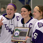 Seniors Tara Baago, Paige Baldwin and Dani Lobejko of the St. Thomas women's hockey team hold the conference title plaque. The women's hockey team was one of six winter sports teams that won the MIAC championship. (Andrew Brinkmann/TommieMedia)