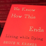 """""""We Know How This Ends,"""" Bruce Kramer and Cathy Wurzer's book, is on display at Wednesday's event. Wurzer held a book signing and met the people who their work impacted. (Eric Bromback/TommieMedia)"""