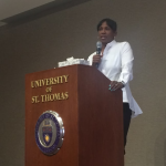 Jackie Joyner-Kersee speaks in Woulfe Alumni Hall Thursday. Joyner-Kersee is a retired American athlete who participated in the long jump and heptathlon events in four Olympic games. (Lauren Andrego/TommieMedia)