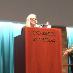 Poet Paula Meehan reads her prose to the audience in the auditorium of  O'Shaughnessy Education Center on April 24.  Meehan recently received the Lawrence O'Shaughnessy Award for Poetry from the St. Thomas Center for Irish Studies. (Jeffrey Langan/TommieMedia)