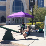 Student volunteers teeter-totter during their one-hour shift of the marathon. The Teeter-Totter Marathon  has been an Ireland Hall tradition since 1990 and is used to raise awareness about domestic abuse and sexual assault. (Margaret Galush/TommieMedia)