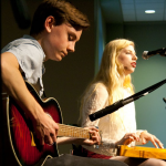 "Luke Mathison and Shannon Kelly perform ""Sheridan Boulevard"" at Scooter's on Tuesday. The song is part of the 10-song ""UST Sampler Vol. 1,"" which KUST, the student-run campus radio station, produced. (Zach Neubauer/TommieMedia)"