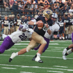Linebacker Jesse Addo lunges to take down Wisconsin-Eau Claire quarterback J.T. DenHartog. The Tommies routed the Blugolds 62-7 in their first game of the season. (Tom Pitzen, TommieMedia)