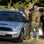 Law enforcement search for a suspect in a mass shooting that occurred at a Southern California social services center on Wednesday, Dec. 2, 2015, in San Bernardino, Calif. One or more gunmen opened fire Wednesday at a California center that serves people with developmental disabilities, shooting several people as others locked themselves in their offices, desperately waiting to be rescued by police, witnesses and authorities said. (AP Photo/Chris Carlson)
