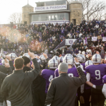 Tommie players and fans join to sing the St. Thomas fight song after last Saturday's NCAA playoff win over Wabash. St. Thomas will face Linfield in the NCAA semifinals Saturday. (Jake Remes/TommieMedia)