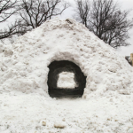 Not to be confused with an igloo, this quinzhee stands in front of the St. John Vianney Seminary on campus. The group of seminary students that fashioned it said they hope it becomes a tradition for future classes. Photo by Carlee Hackl.