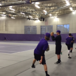 The St. Thomas baseball team gets loose before practice inside the Anderson Athletic and Recreation Complex. The Tommies beat Augsburg 3-2 in the first game of a doubleheader Wednesday afternoon. (Taylor Smith/TommieMedia)