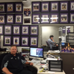 St. Thomas softball coach John Tschida has a wall in his office at the McCarthy Gym filled with photos of the All-Americans that he has coached during his tenure. Tschida recently coached his 1,000th career NCAA game. (TommieMedia/Taylor Smith)