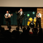 Big Spence and the Gents performs for the first time at the 2013 Catholic Studies talent show in the O'Shaughnessy Education Center auditorium. The band was created about two weeks prior to its first performance. (Photo courtesy of Spencer Leffler)