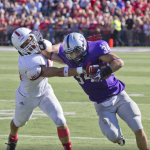 "Running back Brenton Braddock stiff arms a Johnnie defender in 2013. This year, ESPN's ""SportsCenter on the Road"" will join the pregame festivities. (Jake Remes/TommieMedia)"
