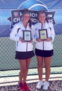 St. Thomas women's tennis players Kara Lefsrud and Bridget Noack receive a plaque for their All-American status Sunday. They won five matches in the ITA tournament at Gustavus this weekend. (Photo courtesy of Kara Lefsrud)