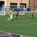 St. Thomas defensive midfielder McKenna Peplinski takes a shot on the goal. The Tommies defeated the __ without giving up a single point. (Taylor Smith/TommieMedia)