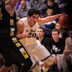 Forward Ryan Boll weaves past Gustavus. Boll made three rebounds and scored 12 points for the Tommies Wednesday night. (Carlee Hackl/TommieMedia)